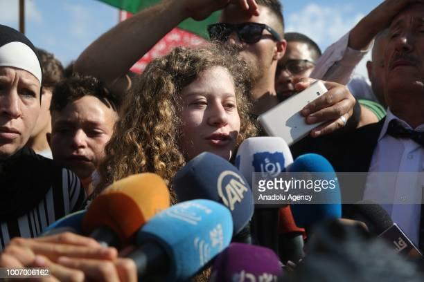 The 16yearold Palestinian Ahed alTamimi who was awarded the 'Hanzala Award for Courage' in Turkey flanked by her mother Nariman Tamimi speaks to...