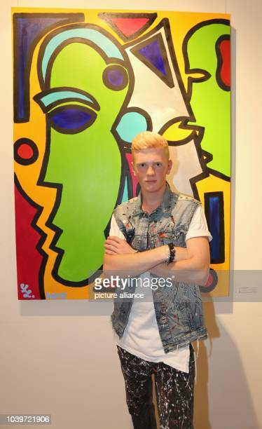 The 17year old painter Leon Loewentraut poses in front of his acrylic painting 'Die Gedanken sind frei' during his vernissage 'The Young Hungry' at...