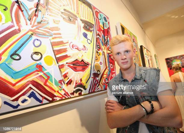 The 17year old painter Leon Loewentraut poses in front of his acrylic painting 'Kuenstler in Aktion' during his vernissage 'The Young Hungry' at the...