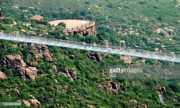 The 188-metre-long 5D Glass Suspension Bridge is seen at Wan'anshan Grand Canyon on July 21, 2018 in Luoyang, Henan Province of China. The 5D Glass...