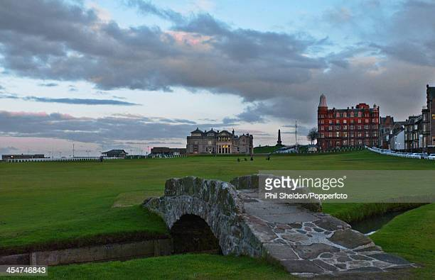 The 18th hole and the Clubhouse with the Swilcan Bridge in the foreground at St Andrews Golf Course in Scotland circa 1990