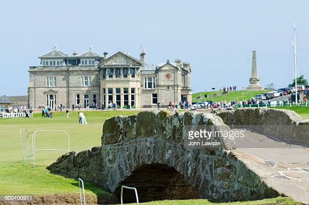 The 18th hole at St. Andrews Old Course, St. Andrews, Scotland. The foreground features the Swilcan Bridge which crosses the Swilcan Burn, a small...