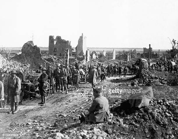 The 18th Infantry Machine Gun Battalion passing through the ruins of St Baussant France in advance upon St Mihiel Front on September 13 1918 Photo...
