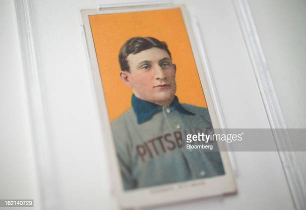The 1909 baseball card of Pittsburgh Pirates shortstop Honus Wagner is displayed for a photograph in New York US on Tuesday Feb 19 2013 The trading...