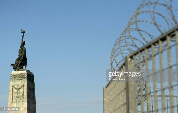 The 1922 bronze sculpture Statue of Liberty or Statue of Freedom by Greek sculptor Gregorios Zevgolis is seen next to barbed wire on the island of...