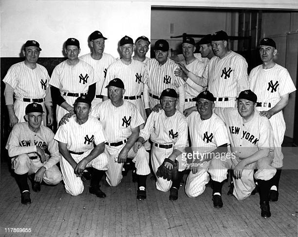 The 1923 New York Yankees pose for a team portrait during the 25th anniversary celebration of the opening of Yankee Stadium on June 13, 1948 in the...