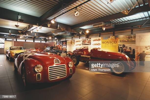 The 1947 Ferrari 125 S on display beside the1935 Alfa Romeo Monoposto 8C-35 Type C at the Ferrari Museum on 6 February 2002 at the Museo Ferrari,...
