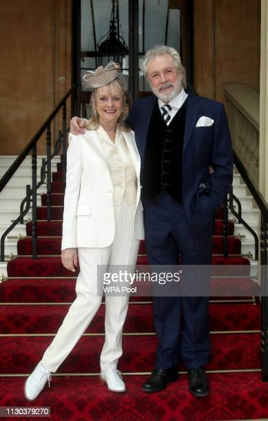 """The 1960s supermodel Lesley """"Twiggy"""" Lawson with husband Leigh arrive at Buckingham Palace where she will be made a Dame Commander of the Order of..."""
