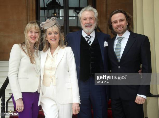 The 1960s supermodel Lesley Twiggy Lawson with husband Leigh son Jason and daughter Carly arrive at Buckingham Palace where she will be made a Dame...
