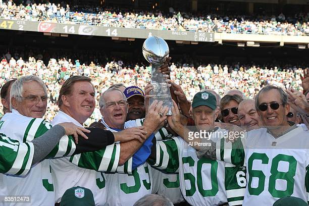 The 1968 New York Jets hold the Super Bowl Trophy aloft in a halftime ceremony honoroing the Super Bowl III team during the Jets game against the...