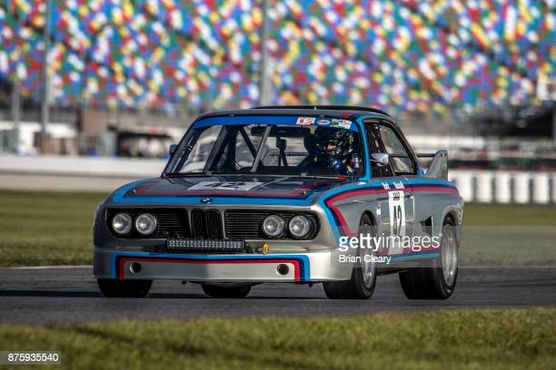 The 1973 BMW CSL of Dick York and David Russell races on the track during the Classic 24 at Daytona Historic Sportscar Race at Daytona International...