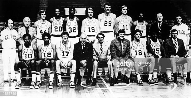 The 197374 NBA Champion Boston Celtics pose for a team portrait at the Boston Garden in Boston MA Seated from left Jo Jo White Don Chaney John...