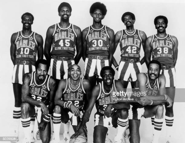 The 197677 National Unit Harlem Globetrotters team Kneeling Nate Branch Curly Neal Meadowlark Lemon and Jackie Jackson Standing Dallas Thornton...