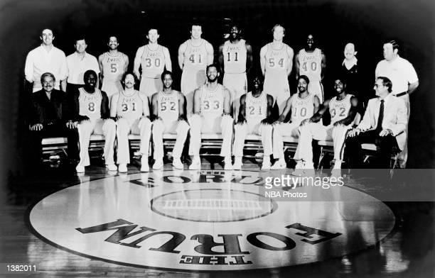 The 198182 NBA Champion Los Angeles Lakers pose for a team portrait at the Forum in Los Angeles California Front row Owner Jerry Buss Jim Brewer Kurt...