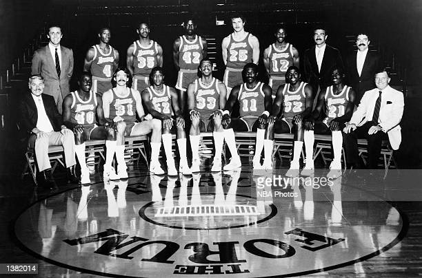 The 198485 NBA Champion Los Angeles Lakers pose for a team portrait at the Forum in Los Angeles CA Front row Owner Dr Jerry Buss Mike McGee Kurt...