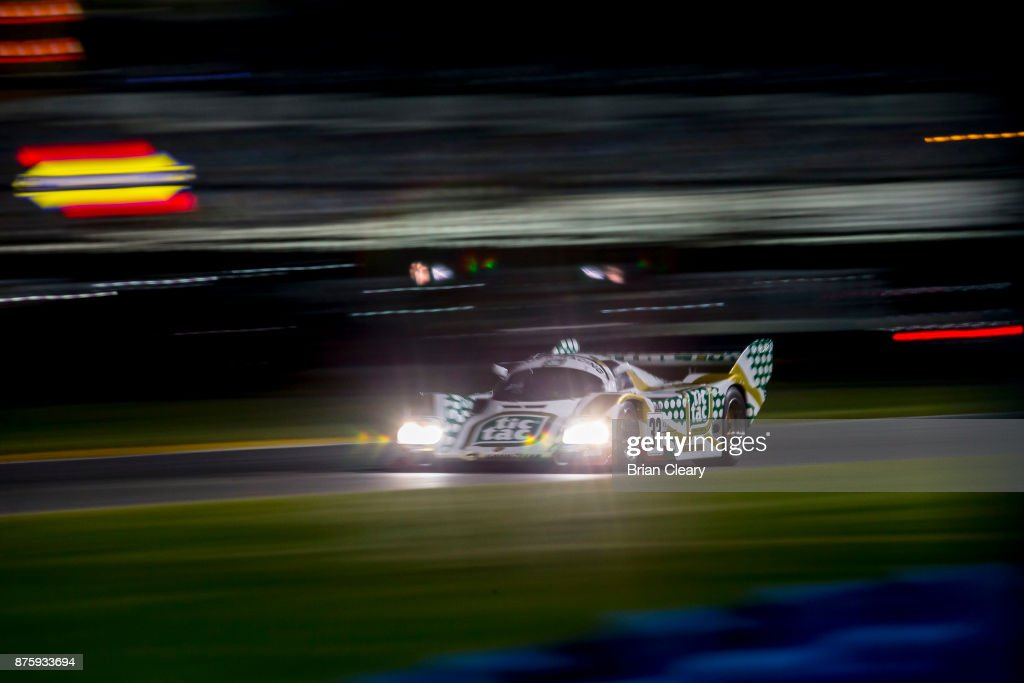 The #33 1989 Porsche 962 of Henrick Lindberg races on the track at night during the Classic 24 at Daytona Historic Sportscar Race at Daytona International Speedway on November 11, 2017 in Daytona Beach, FL.