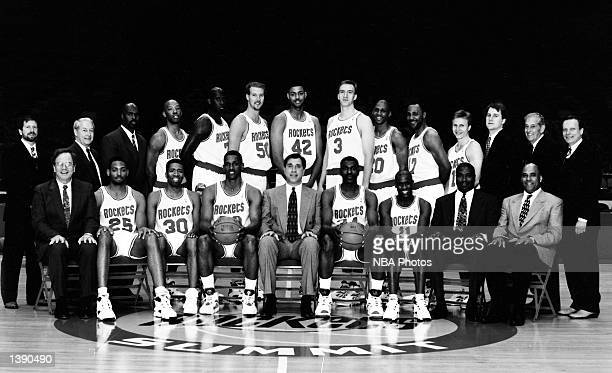 The 199394 NBA Houston Rockets pose for a team portrait at the Summit in Houston TX Front row Carroll Dawson Robert Horry Kenny Smith Otis Thorpe...