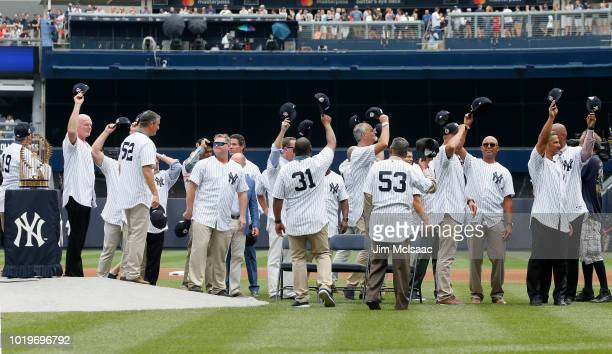 The 1998 New York Yankees World Series Championship team acknowledges the crowd during a ceremony prior to a game between the Yankees and the Toronto...