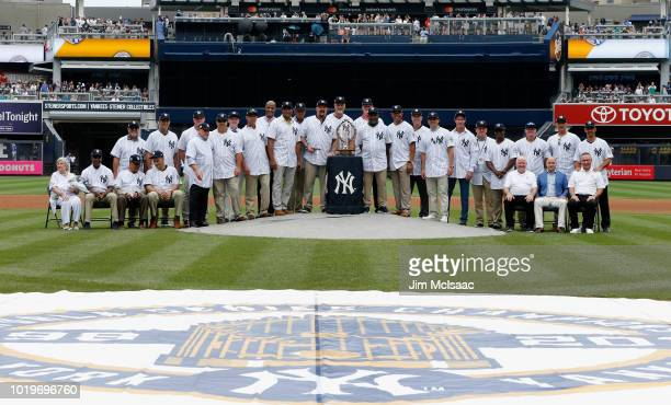 The 1998 New York Yankees World Series Championship team pose for a photograph during a ceremony prior to a game between the Yankees and the Toronto...