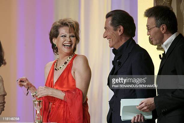 The 19th night of the Molieres at the Mogador Theatre in Paris France on May 09 2005 Claudia Cardinale William Leymergie and Laurent Ruquier