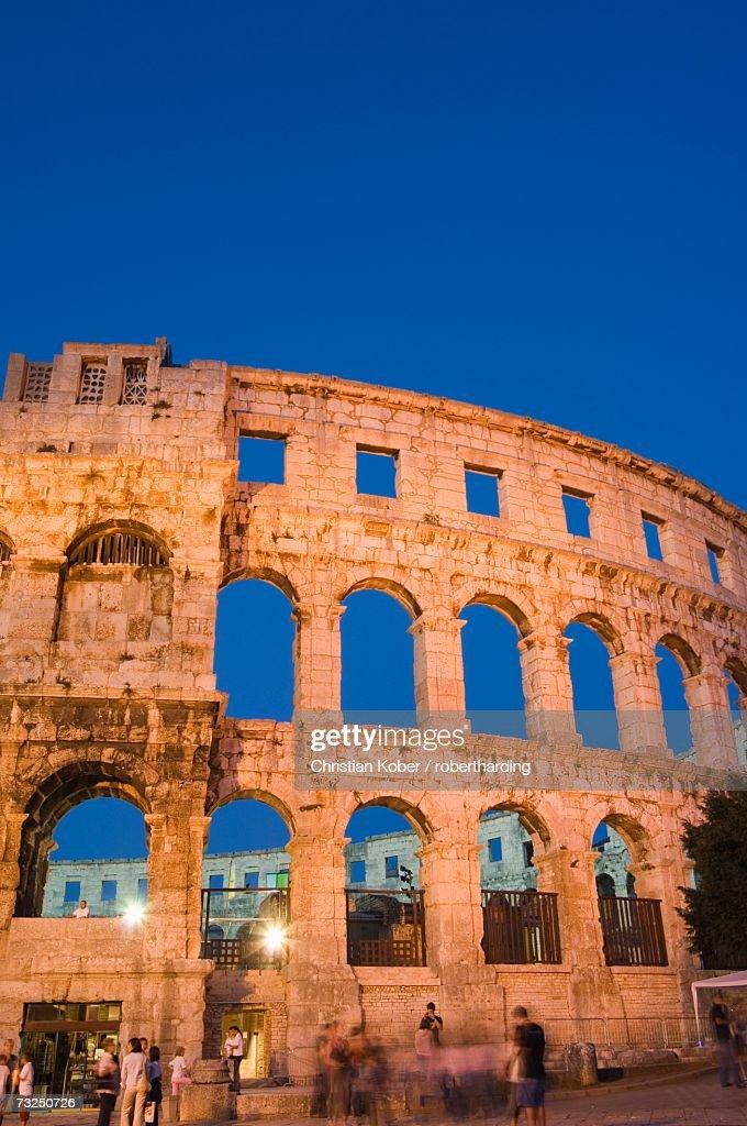 The 1st century roman amphitheatre bathed in early evening light the 1st century roman amphitheatre bathed in early evening light pula istria coast croatia europe publicscrutiny Images