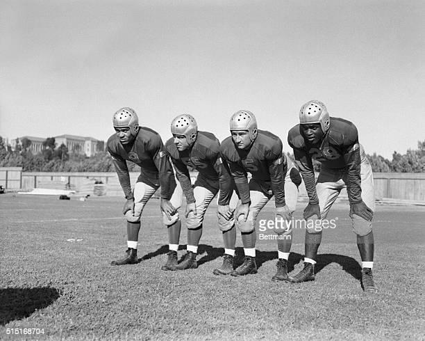 The 1st string backfield of the UCLA football team left to right Ray Bartlett right halfback Ned Matthews quarterback Bill Overlin fullback Jackie...