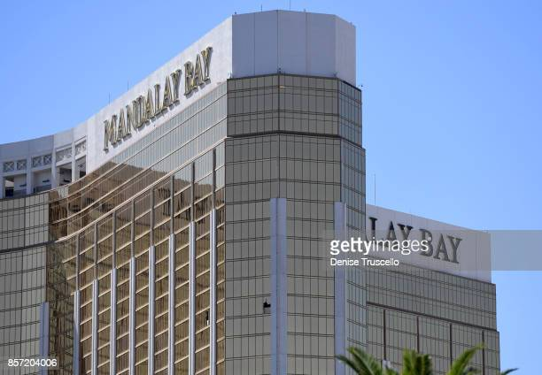 The 2 broken windows on the 32nd floor of the Mandalay Bay Resort and Casino where a lone gunman identified as Stephen Paddock of Mesquite Nevada...
