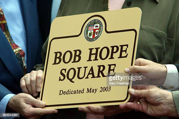 """The 2 sons and daughter of Bob Hope holds a commemorative plaque which designated the intersection of Hollywood and Vine was as """"Bob Hope Square.""""..."""