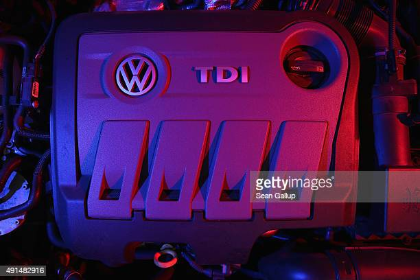 The 20 turbodiesel engine of a 2014 Volkswagen Passat passenger car affected by the Volkswagen diesel emissions software scandal stands illuminated...