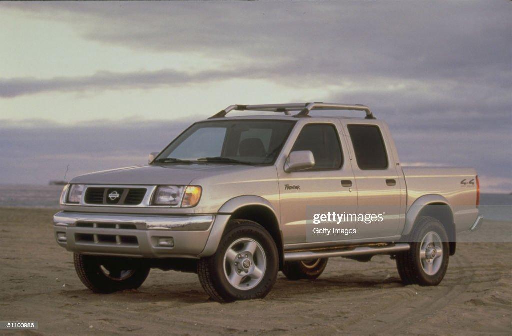 High Quality The 2000 Nissan Frontier Crew Cab 4 Door Light Pickup Truck : News Photo