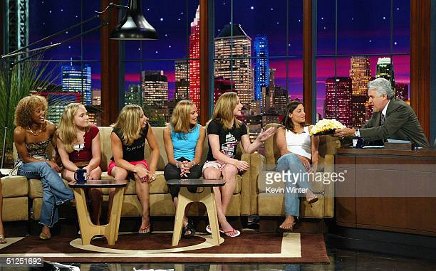 The 2004 US Olympic Women's Gymnastic Team Annia Hatch Courtney McCool Courtney Kupets Terin Humphrey Carly Patterson and team captain Mohini...