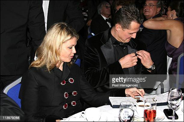The 2006 FIA Gala held in Monaco city Monaco On December 08 2006Michael Scumacher put on his jacket next to his wife Corinna the special FIA gold...