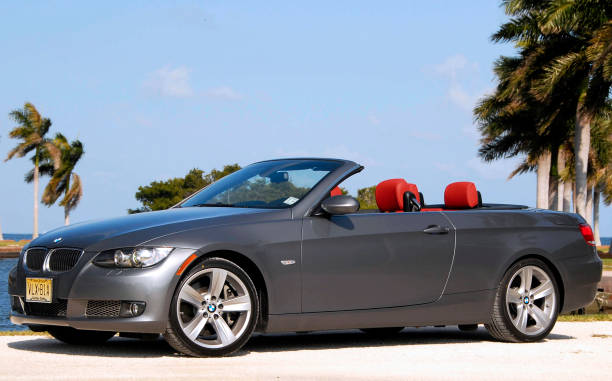 The 2007 BMW 335i Convertible is displayed with the top down ...