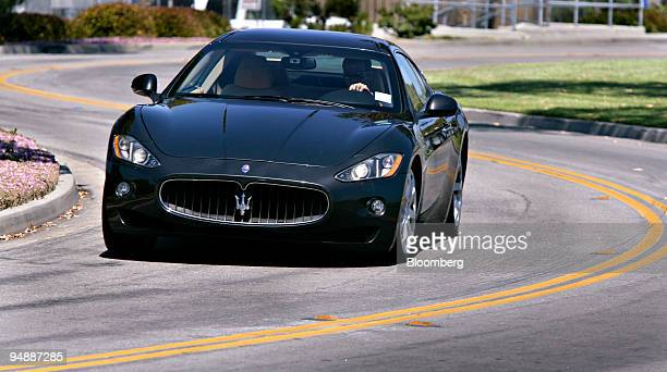 The 2009 Maserati GranTurismo is driven around a curve in Dana Point California US on Friday June 6 2008 The car is powered by a 42liter V8 engine...