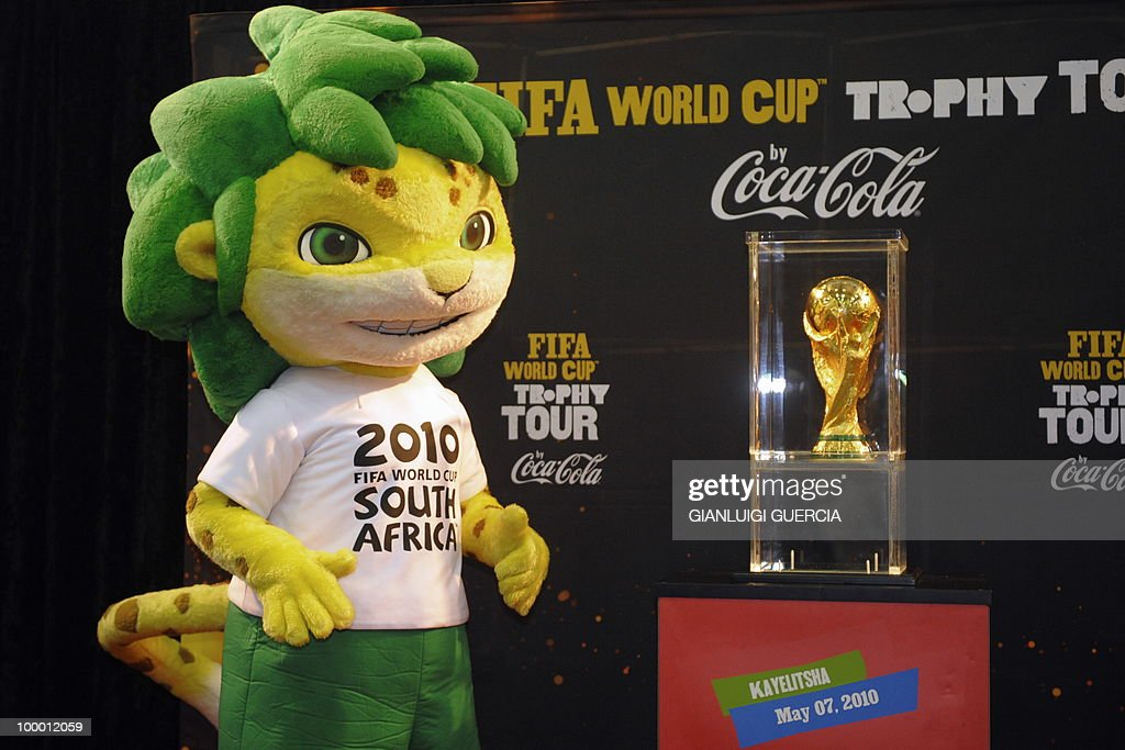 The 2010 FIFA World Cup mascotte, Zakumi, poses on stage after the unveiling of the FIFA world cup trophy on May 7, 2010 during the kick off of its South African tour in Kayelitsha on the outskirt of Cape Town, South Africa.