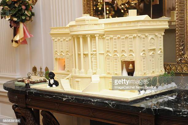 The 2010 White Chocolate Gingerbread House features marzipan replicas of the Obama family dog Bo as well as and two detailed interiors the State...