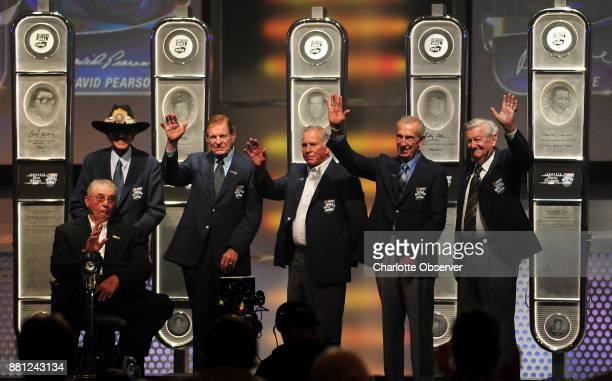 The 2011 NASCAR Hall of Fame class from left Maurice and Richard Petty accepting for their father Lee Petty Bud Moore David Pearson Ned Jarrett and...