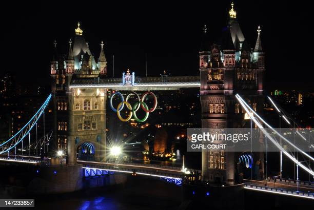 The 2012 Olympic rings are pictured on London's Tower Bridge in London on June 27 2012 The 25 metres wide and 115 metres tall Olympic rings were...