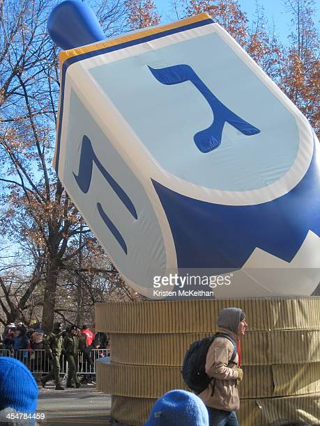 The 2013 Macy*s Thanksgiving Day Parade concluded with this tall blue and white dreidel float that came down Central Park West along the parade route...