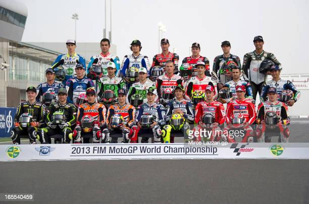 The 2013 MotoGP riders pose on the track for photographers during the MotoGp of Qatar - Previews at Losail Circuit on April 4, 2013 in Doha, Qatar.
