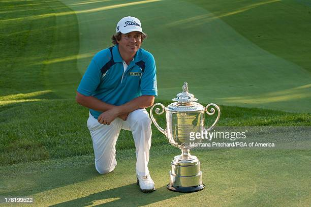 The 2013 PGA Champion Jason Dufner of the United State poses with the Wanamaker Trophy during the Champion Presentation at the 95th PGA Championship...