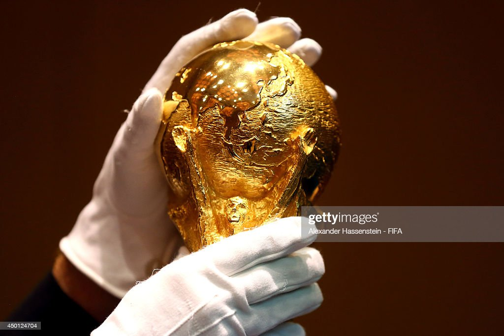 The 2014 FIFA World Cup Winner's Trophy is prepared to displayed for a Press Conference after the 2014 FIFA World Cup Organising Committee meeting at the Grand Hyatt Sao Paulo Hotel on June 5, 2014 in Sao Paulo, Brazil.