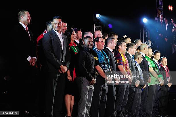 The 2014 NRL team captains along with selected club members appear on stage during the 2014 NRL official season launch at Sydney Exhibition Centre on...