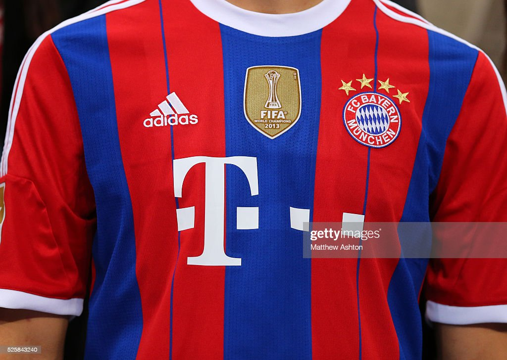 sports shoes 48ec9 3adb1 The 2014-2015 Adidas kit of Bayern Munich with a gold badge ...