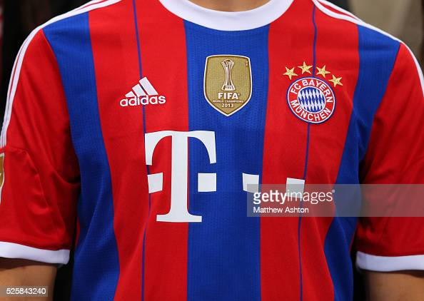 sports shoes f2d75 c8e3c The 2014-2015 Adidas kit of Bayern Munich with a gold badge ...