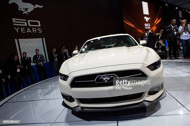 The 2015 Ford Mustang 50 year Limited Edition is introduced during a media preview of the New York International Auto Show at the Jacob Javits Center...