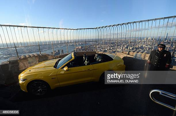 The 2015 Ford Mustang convertible is revealed at the top of the Empire State Building in New York April 16 2014 Fifty years ago Ford Motors debuted...