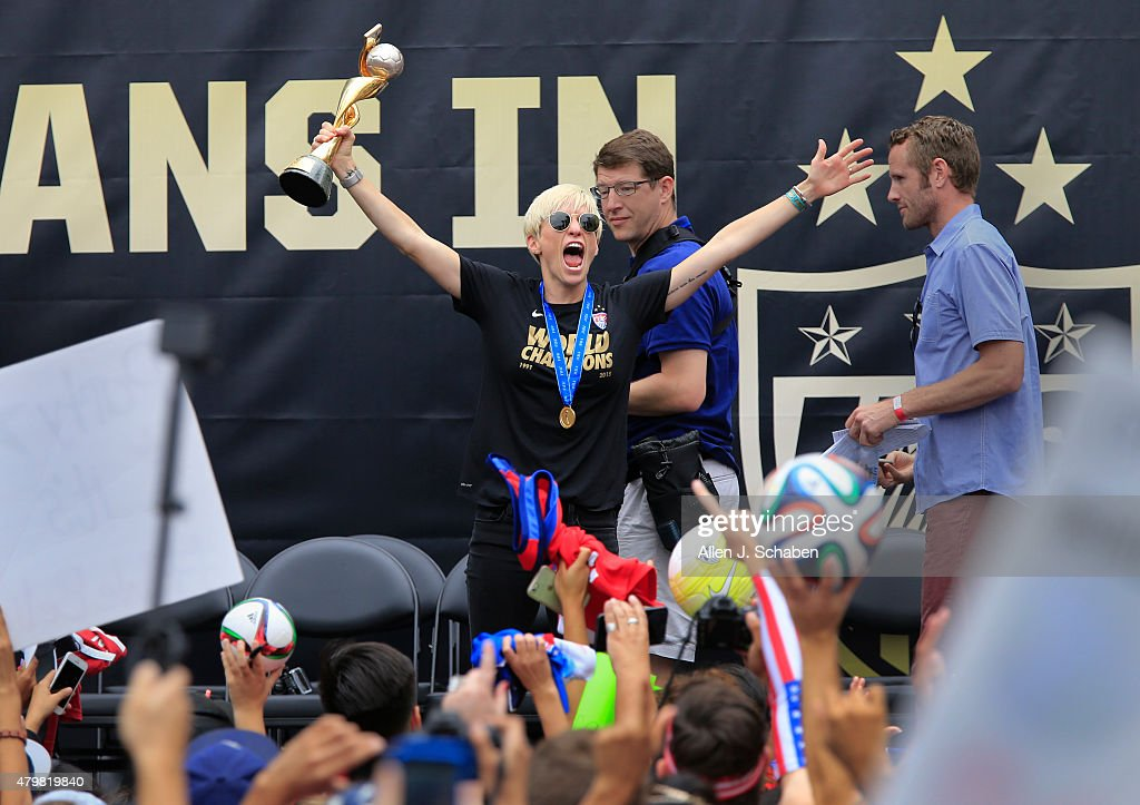 The 2015 Midfielder Megan Rapinoe hoists the FIFA Women's World Cup to fans while celebrating with the United States Women's National Soccer Team at a free, public championship celebration at L.A. Live's Microsoft Square in Los Angeles, Calif., on July 7, 2015.