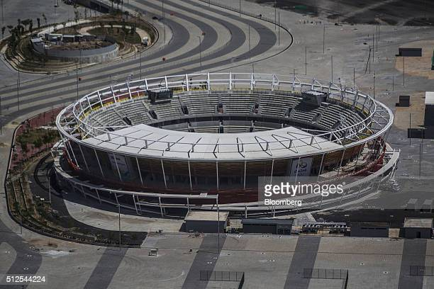 The 2016 Summer Olympics stadium stands in the final stages of construction in this aerial photograph taken above the Barra da Tijuca area of Rio de...