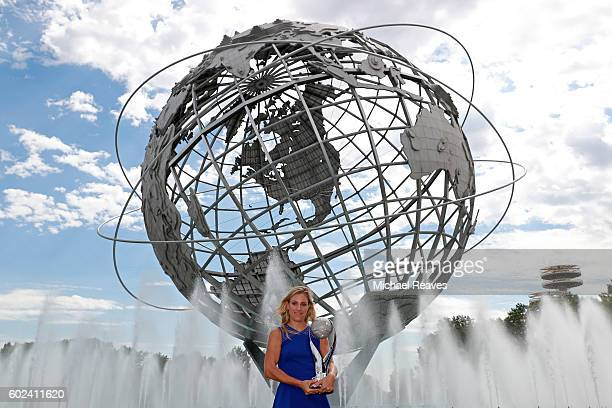 The 2016 US Open Women's Singles champion Angelique Kerber of Germany poses with her trophy on Day Fourteen of the 2016 US Open at the USTA Billie...